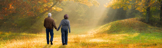 couple walking in woods remembering life