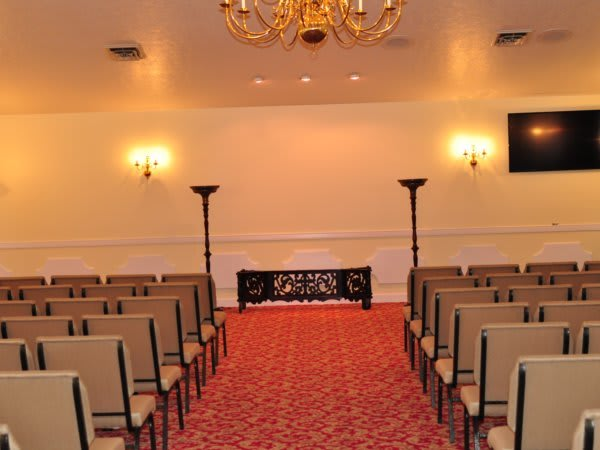 Spacious Chapel with 60'' Television Screen to view slide shows.