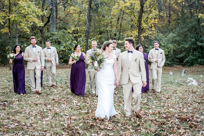 Bride and groom and wedding party at fall wedding