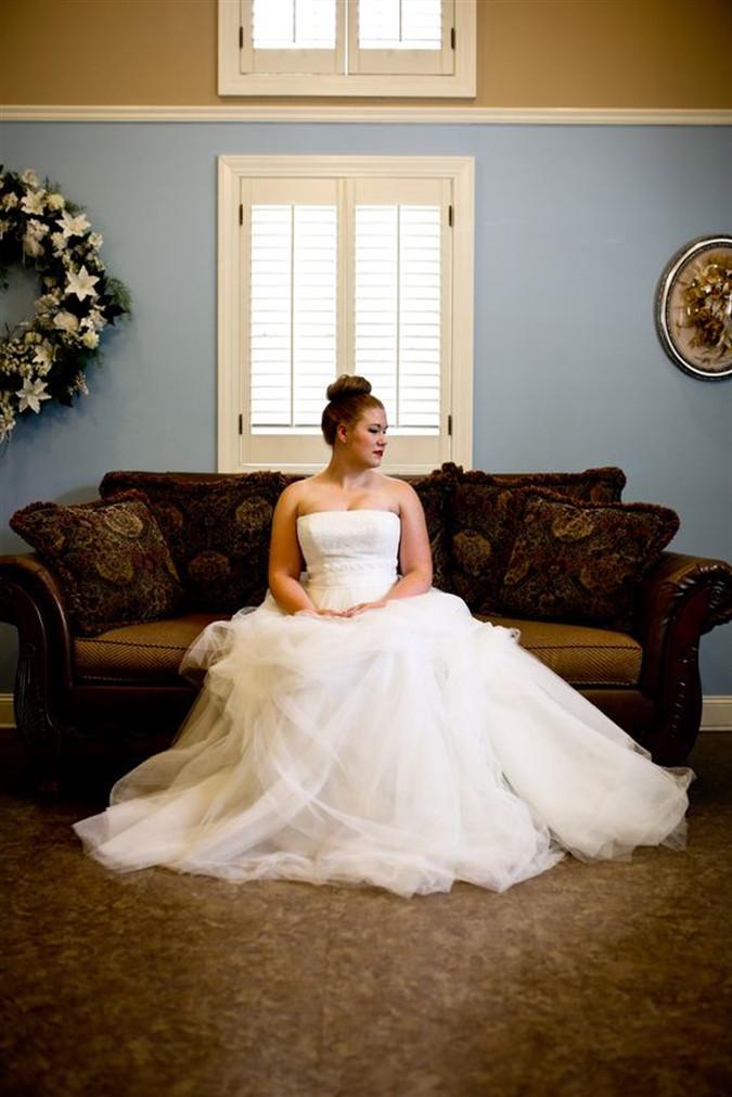 Bride sitting on sofa at Smithview Pavilion's bridal suite