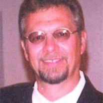 """William L. """"Larry"""" Holcomb, Jr."""
