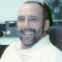 Dennis E. Loy