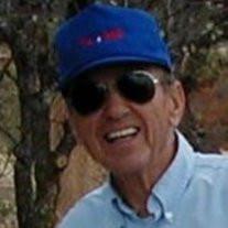 Robert E Sholle