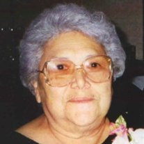 Dora E. Flores