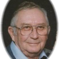 Everett J Carmin