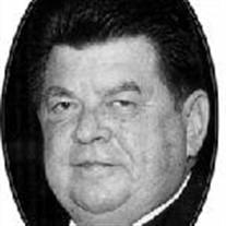 DENNIS L. WODOWSKI