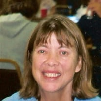 Martha E. Thomas