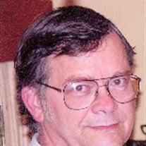 Larry E. Dollens