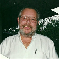Glenn E.  Brewer