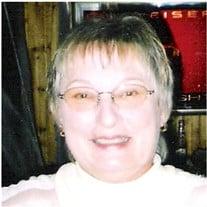 Mrs. Jean M. Benavides