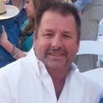 Greg F. Holland