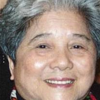 Mrs Kwan Hing IP CHOW