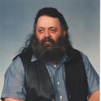 "LARRY J.  ""HEAVY"" MOORE"