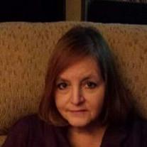 Tammi E. DeLeon