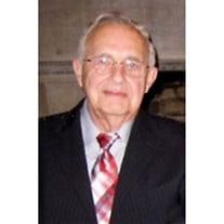William E. Riggs,