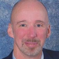 Kenneth E. Mueller