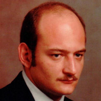 Mark A. Compton