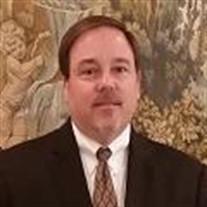 Dennis L. Dollar