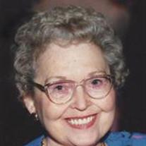 Maxine E Riley