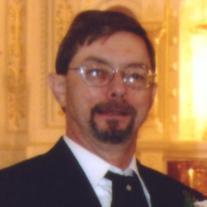 Lance E.  Ames