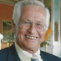 KEITH E. STEINMAN