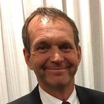 Chris L. Mitton