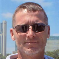 John E. White Jr.