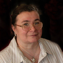 Joan J Volland