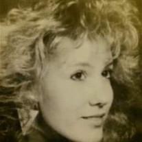 Kathy E.  Brewer