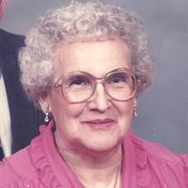 LELA M. BARKER