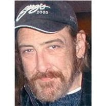 William E. Devine