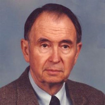 Burton L.  Mann