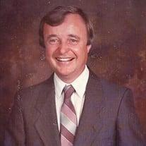 "Elwood Eugene ""Gene"" Strickland"