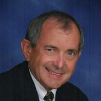 "Robert  M. ""Mitch"" Grundman"