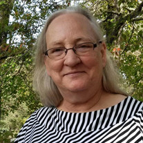 Ms. Julie Catherine Brown