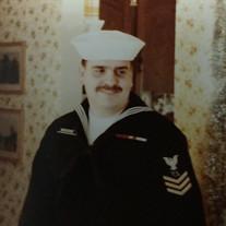 Kenny L. Moore