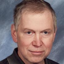 Steven R.  Adams