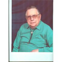 Donald E Malcom