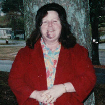 Ms. Flora Mae Dockery