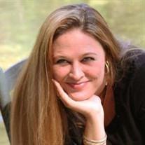 Mrs. Angela Rena' Travis