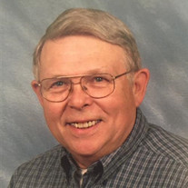 Charles E Strickland, Jr.