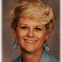 Ms. Evie T. Wombles