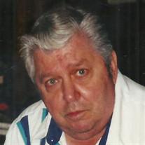 Raymond A.  Komara