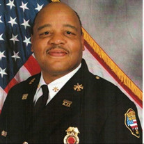 Retired District  Chief Henry Booker Jr.