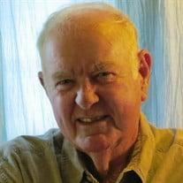 Tom E.  Wilson