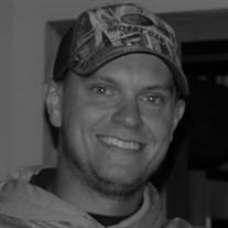 Aaron J Cox