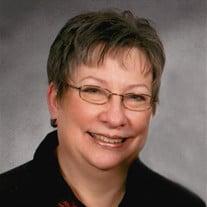 Suzanne E. Riley