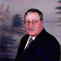 John B.   Langas