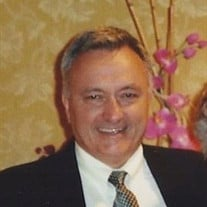 Charles A.    Paquette