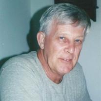 Raymond M Alarie